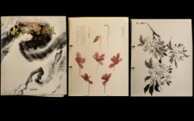 Japanese Art Book containing a large collection of Sepia and coloured prints by notable artists,