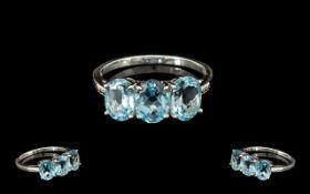 Sky Blue Topaz Trilogy Ring, three oval cut sky blue topaz stones, totalling 4.