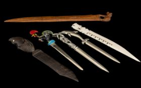 Collection of Vintage Paper Knives with handles depicting animals and birds, in carved,