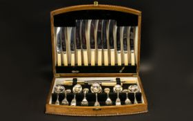Oak Boxed Canteen Of Cutlery Hinged box with beaded border, lined to interior in black velvet,