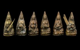 A Rare Set of Antique Tibetan Bronze Figures depicting Lamas seated as Buddhas on Lotus thrones,