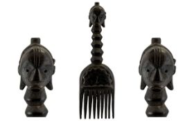"Africa Tribal Comb the handle in the form of a head with an elongated neck. 12"" in length."