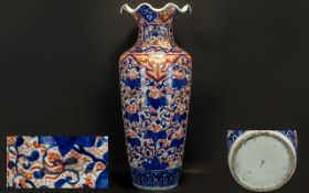 Large Antique Imari Vase with a wavy top,