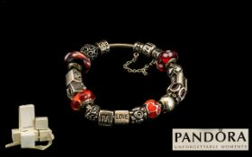 Pandora Silver Charm Bracelet Together With 16 Charms, Comprising 3 Glass Beads,