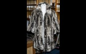 Ladies Faux Fur Fashion Jacket in brown/beige colour, elbow length sleeves, two slit pockets and two