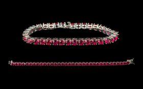 Ruby Tennis Bracelet, 34 round cut rubies of rich, glowing red,