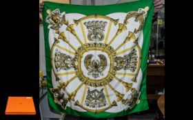 Hermes Vintage Scarf in classic design with green, gold and white background.