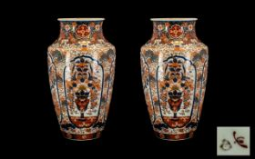 Pair Antique Imari Meiji Period Vases of typical palette, four decorated panels to the body,