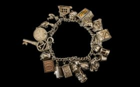 Sterling Silver Nice Quality Charm Bracelet - loaded with 20 silver charms, some interesting ones.