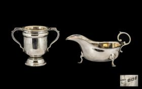 Silver Sauce-boat Swan Neck and Hoofed Feet with Curved C Handle.