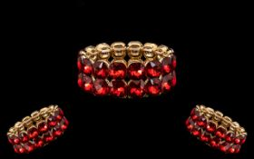 Bright Red Crystal Bracelet comprising a double row of large, dazzling red, square cushion crystals,