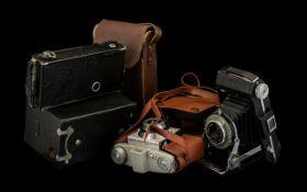Four Vintage Cameras by Kodak Brownie, A