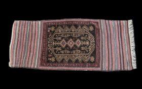 A Turkish Woven Wool Carpet burgundy an