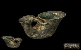 Chinese Archaic Bronze Deers Head Cup with green Patination character marks to the base.