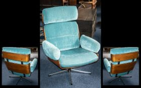 Retro Swivel Armchair by Guy-Rodgers, on a 5 star cruciform base, laminated sides and back.