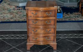 Small Reproduction Mahogany Serpentine Fronted Chest of Drawers with graduated drawers with fitted