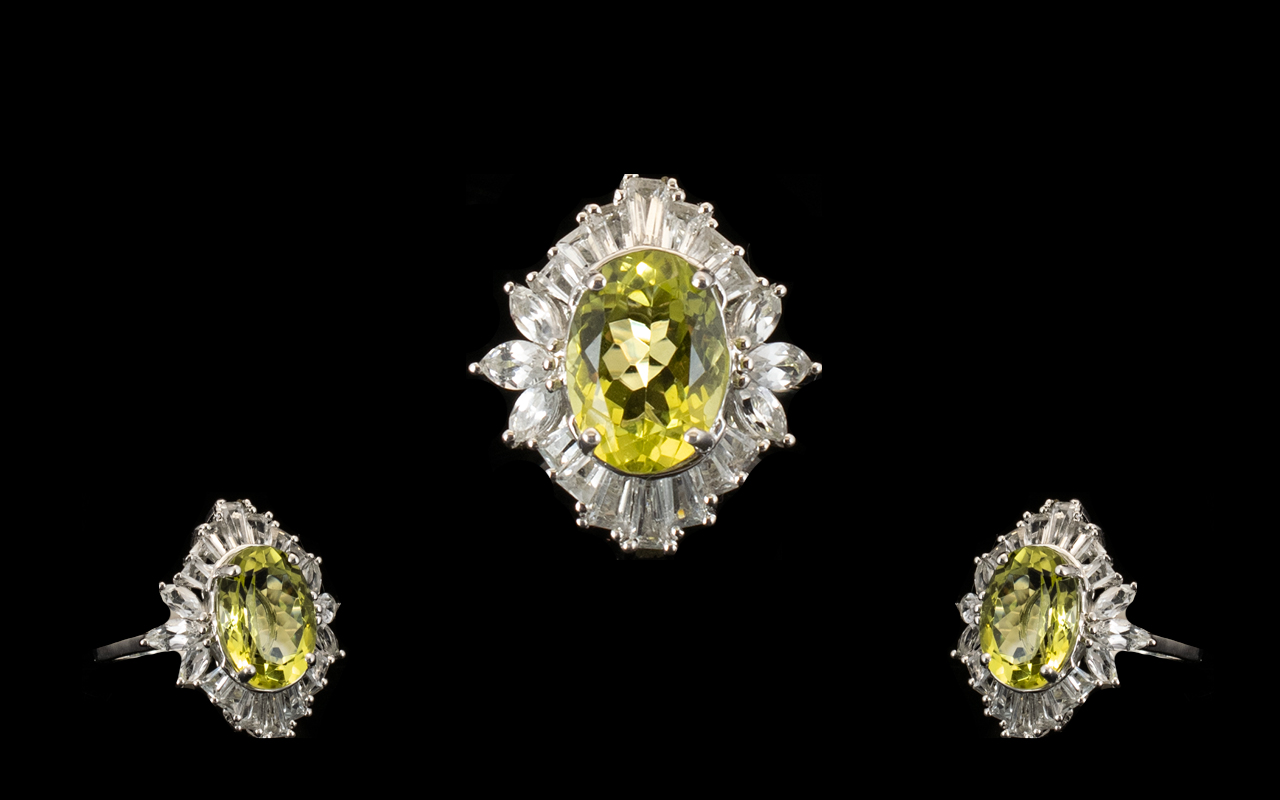 Lot 311 - Ouro Verde Quartz and Topaz Statement Ring, an oval cut natural green gold quartz of 6cts, framed
