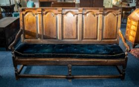 Antique Oak Settle with an arched raised panel back,
