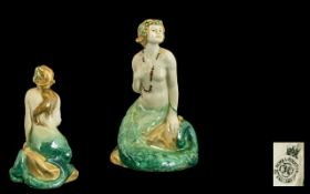 Royal Doulton Early Handpainted Figure stamped 1918. 'The Mermaid' green / cream colour way. HN 97.