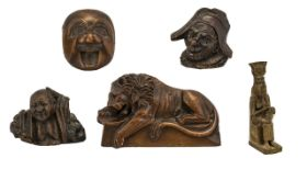 A Fine Collection of Five Small Antique Wood Carvings a finely carved German pipe head of Punch