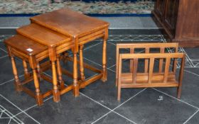 A Nest of Three Oak Reproduction Tables on turned legs with cross stretchers.