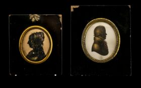 Two 19thC Silhouettes with gilt highlights both in gilt metal mounts with black lacquered frames.
