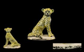 Porcelain Decorated Figure of a Seated Leopard wearing a blue collar (signed Basil Matthews) with