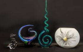 Two Coloured Glass Art Sculptures one in cobalt and blue shades raised on a black glass plinth