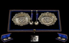 Late Victorian Period Boxed Pair of Silver Salts With Spoons. Ornate shaped borders.