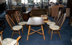 Ercol Elm Golden Dawn Dining Room Set comprising an oval drop-leaf table with four Windsor back