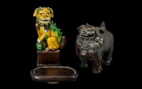 An Antique Chinese Figure of Foo Dog Sancai glazed. 6.5 inches high.