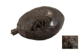 An 18thC Dutch Colonial Carved Coconut Shell 'Beast' Water Flask carved to the body with swags and