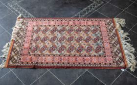 Persian Carpet, extremely fine quality, with a Tekke design to the central panel, vibrant colour.