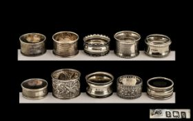 Silver Napkin Rings - a large collection of hallmarked silver napkin rings,