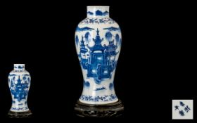 Chinese Mid 19th Century Waisted Shaped Blue & White Vase decorated with images of buildings,