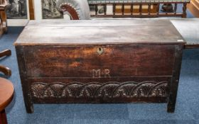 Early Oak Plank Top Coffer of Good Patination - carved to the block front with initials M.R.