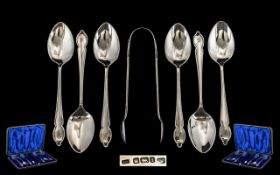 Edwardian Period Boxed Set of Six Silver Teaspoons with Matching Sugar Tongs.