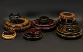 10 Chinese Oriental Wood Stands of various shapes and sizes.