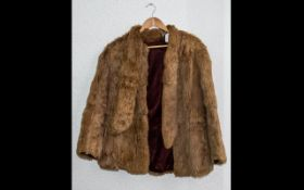 Ladies Golden Coney Fur Jacket with tie neck, hook and eye fastening, fully lined in sateen fabric.