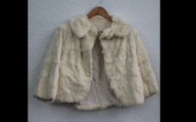 Ladies Cream Fur Jacket. Fastens at top with button. Pale gold lining. Small size 8.