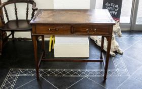 Edwardian Tooled Leather Top Mahogany Writing Desk with two front drawers with key, raised on four