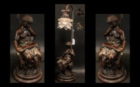 A Modern Decorative Bronzed Table Lamp depicting a classical maiden reading below branches.