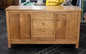 Contemporary Solid Oak Sideboard two cupboard storage areas either side four central drawers.