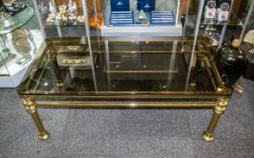 Glass Topped Coffee Table. Attractive tinted glass top table with brass scrolled legs, measures 47''