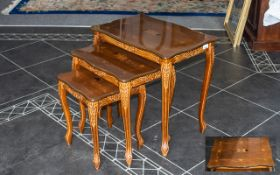 Nest of Three Walnut Tables with inlaid veneer decoration to tops,