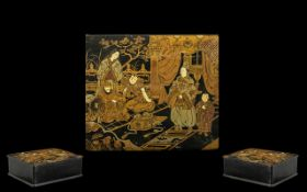 Black Lacquered Victorian Lidded Pape-Mache box. Decorated with oriental figures in a room setting.