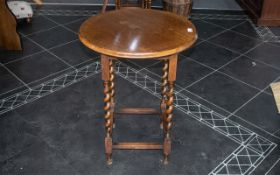 "Circular Oak Candytwist Side Table raised on four legs with stretchers. Height 28.5"", Diameter 21""."