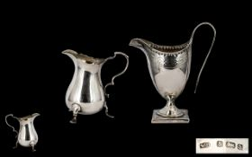 George III Helmet Shaped Silver Milk Jug - on a square base with studded border.