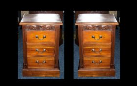 Matched Pair of Mahogany Bedside Cabinets with a carved frieze to the top.