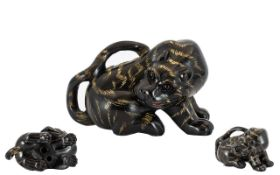 Japanese Boxwood Netsuke in the form of a tiger. Signed. Etched carving detail on stripes.